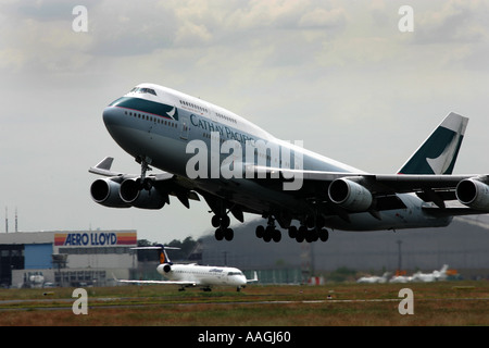 Frankfurt Main airport Fraport Boeing 747 400 Jumbojet of Cathay Pacific Airline - Stock Photo