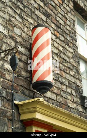 barber shop red and white stripey pole hairdresser shop retail hair hair cut fashion style gents gentlemen stripe - Stock Photo