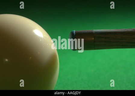 Cue ball and tip on the green baize of a snooker table UK - Stock Photo