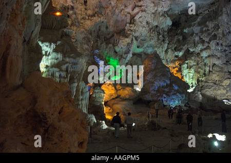 Northeast Vietnam Halong Bay Hang Dau Go Cave of wooden stakes large view with tourists and artificial clourful - Stock Photo