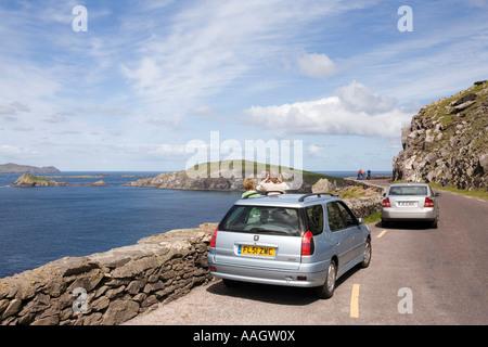Ireland Kerry Dingle Peninsula Slea Head drivers on coastal road parked near Dunmore Head - Stock Photo