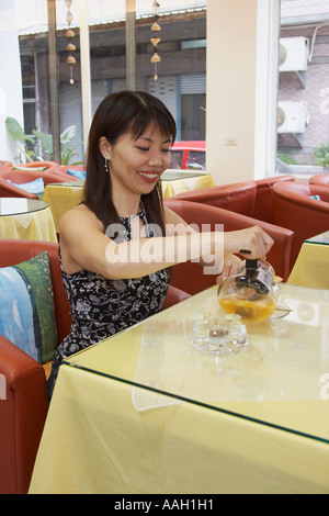 Woman Drinking Tea In Cafe - Stock Photo