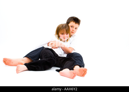 Children Boy Girl Brother Sister Fun Happiness Love Tenterness Hug Cuddle Look Looking Play Run  Kindness - Stock Photo