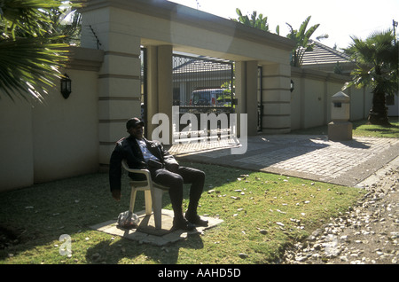 Tired Guard on duty outside luxury home in Rosebank a suburb of Johannesburg South Africa - Stock Photo