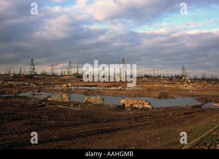 The surreal landscape of an oil field on the Caspian Sea Baku Azerbaijan - Stock Photo