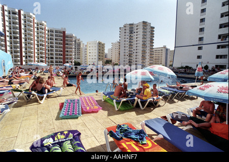 A rooftop swimming pool at the Club Praia Da Rocha hotel on the Algarve in Portugal - Stock Photo