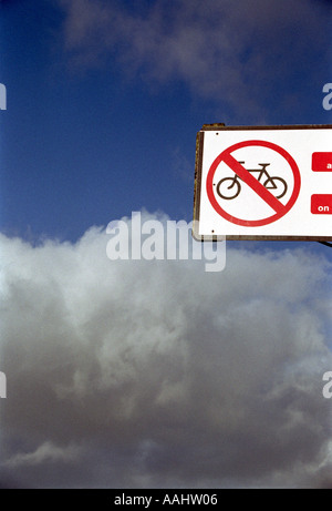 no cycling sign against sky  - Stock Photo