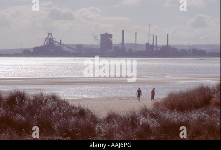 Teesside steelworks seen over the Tees Estuary from Seaton Carew sands, Hartlepool, Cleveland, England, UK. - Stock Photo