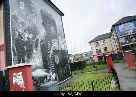 Political mural and republican election poster in the Bogside housing estate, Londonderry, County Derry, Northern - Stock Photo