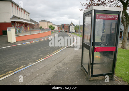 Cathedral Youth Club and vandalised telephone box in The Fountain estate, Londonderry, County Derry, Northern Ireland. - Stock Photo