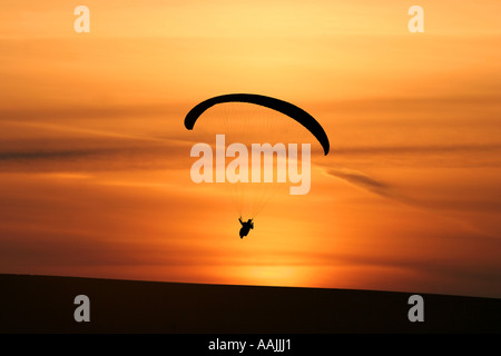 paragliding at sunset - Stock Photo