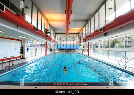 Indoor swimming pool public baths swimming pool open air bath stock photo royalty free image for Open door swimming pool london
