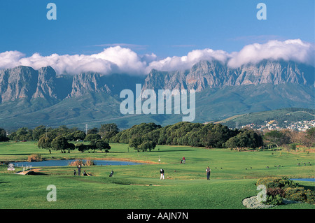 Strand Golf Course with the Hottentots Holland Mountain in distance Western Cape South Africa - Stock Photo