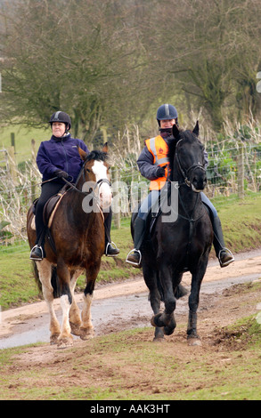 Pony trekkers riding down country lane on a Black Mountains riding loop from Tregoyd Mountain Riders Centre South - Stock Photo