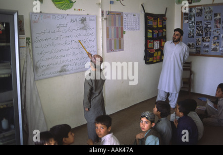 Young Afghan refugees in Quetta Pakistan They pick garbage in the streets as a job and attend an NGO funded school - Stock Photo