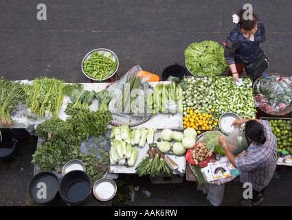 Woman Buying Vegetables At Market - Stock Photo