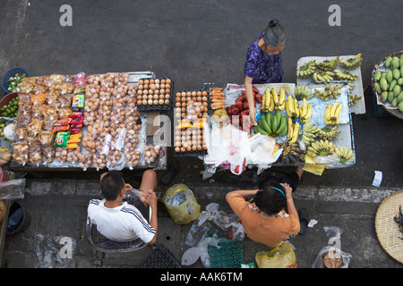 Woman Buying Groceries And Fruit At Market - Stock Photo