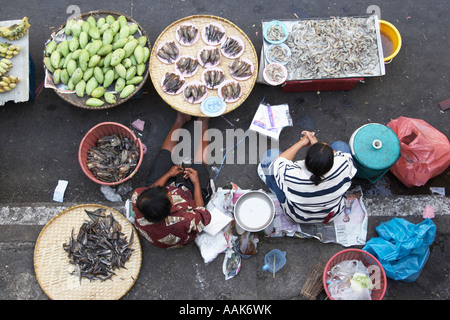 Vendors Selling Fish And Fruit At Market - Stock Photo