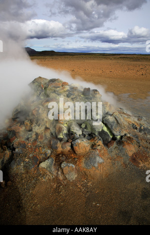 Steaming fumarole Namaskaro in Iceland - Stock Photo