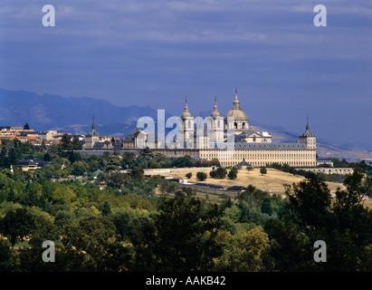 El Escorial monastery with the Sierra de Guadarrama behind San Lorenzo de El Escorial Castilla León Spain - Stock Photo