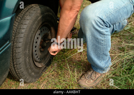 Changing a flat tire - Stock Photo