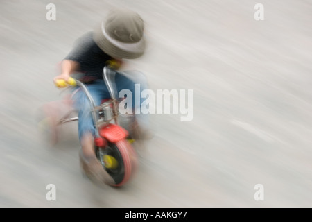 Blurred movement on a tricycle - Stock Photo
