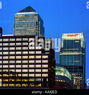 dusk shot of Canary Wharf east London inc illuminated skyscrapers HSBC head office and office blocks - Stock Photo