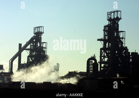 THE STEEL WORKS AT PORT TALBOT ARE SEEN AGAINST A BLUE SKY - Stock Photo
