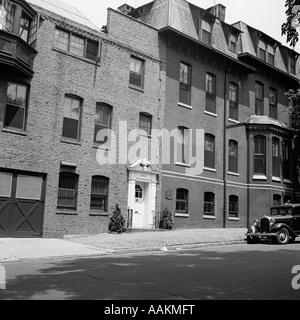 1920s WEST PHILADELPHIA PA BRICK RESIDENCE WITH CAR PARKED ON STREET - Stock Photo
