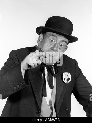 1950s PORTRAIT MAN WEARING OLD-TIME POLITICIAN COSTUME POINTING TOWARD LOOKING AT CAMERA WITH CIGAR IN HAND - Stock Photo