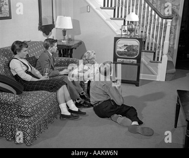 S Group Of Four Young Teenage Boys And Girls Watching Television Aakw N on Jitterbug Dancing