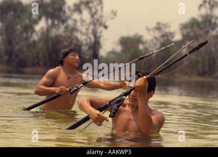 Xingu, Amazon rainforest, Brazil. Yaulapiti indigenous People. Tuatuari river. Acculturated young indians fishing - Stock Photo