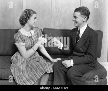1930s Smiling Teen Girl Sitting Autumn Clothes Stock Photo