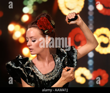 1970s PROUD YOUNG SPANISH LATIN WOMAN FLAMENCO DANCER WITH CASTANETS MUSICAL INSTRUMENT - Stock Photo