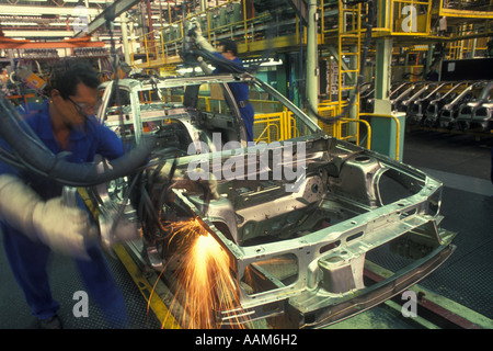Sao Paulo Brazil Factory workers at automobile industry. - Stock Photo