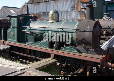 Rusty steam locomotives awaiting restoration in a station yard - Stock Photo