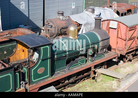 Rusty steam locomotives awaiting restoration in a station yard - Stock Photo