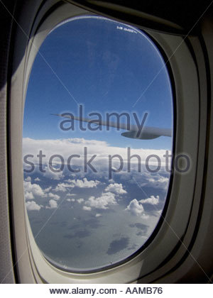 View from cabin through window of international airliner over Atlantic Ocean - Stock Photo