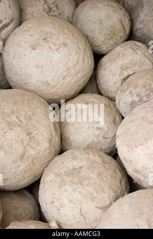 Trebuchet balls excavated from the moat at Pevensey Castle - Stock Photo