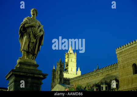 The cathedral of Palermo Italy and a nearby statue are illuminated in the late evening - Stock Photo