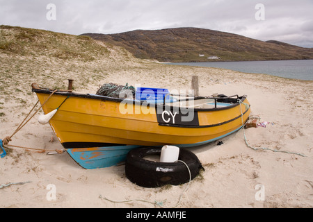 UK Scotland Western Isles Outer Hebrides Vatersay fishing boat on Bagh Bhatersaigh beach - Stock Photo