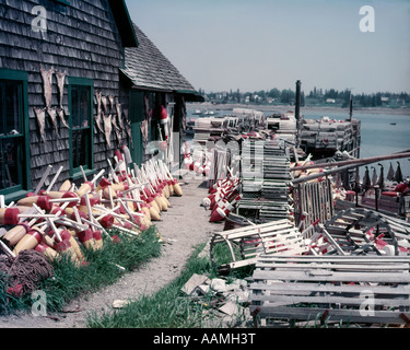 1950s LOBSTER SHACK WITH BUOYS & TRAPS SHINGLED BUILDING MT. DESERT ISLE BERNARD ME COMMERCIAL FISHING INDUSTRY - Stock Photo