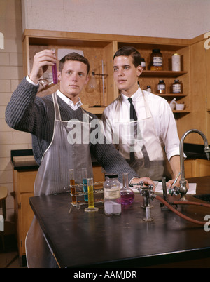 TWO MALE COLLEGE STUDENTS IN SCIENCE LAB - Stock Photo