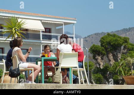 Enjoying a drink tourists on the Costa Tropical southern Spain Europe EU - Stock Photo