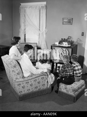 1950s Family With 3 Children Watching Tv Stock Photo