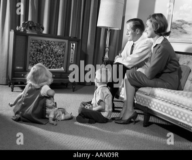 1960s Family Mom Dad Amp 2 Kids Standing In Yard By House