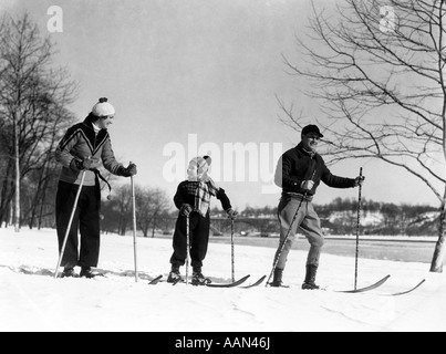 1930s FAMILY OF THREE CROSS COUNTRY SKIING MOTHER FATHER DAUGHTER - Stock Photo