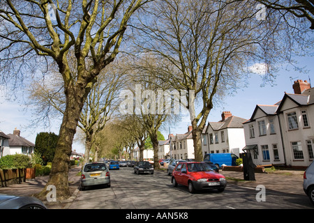 Busy suburban road with cars parked on each side in a 30 mph zone Heath area of Cardiff Wales UK - Stock Photo