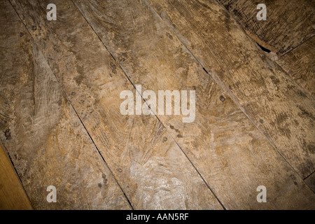 Worn old 15th century oak floorboards in manor house Treowen Wales UK - Stock Photo