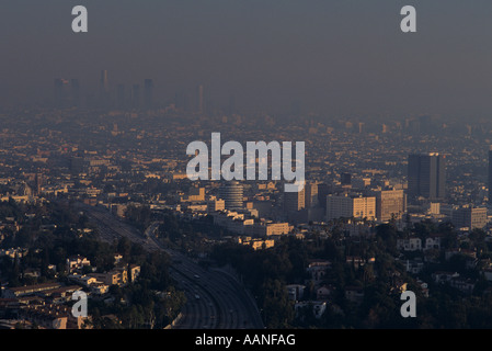 Retro Image 1990's Los Angeles skyline sunset view from Mulholland Drive heavy smog in the air Los Angeles California - Stock Photo